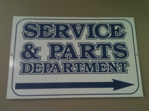 A Parts and Service Department direction sign at Vallery Ford, Waverly, Ohio